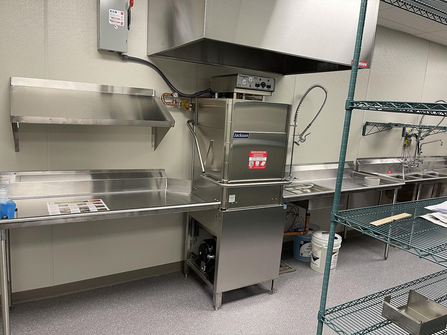 Warewashing station in commercial kitchen